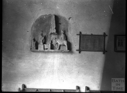 Carved nativity niche and Kindred & Affinity table in an unknown church c.1900s