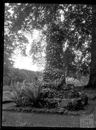 Ivy-covered cross shaft in an unknown churchyard location c.1900s
