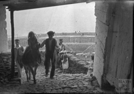 Ascending the cobbles on a donkey in Clovelly, c.1930s