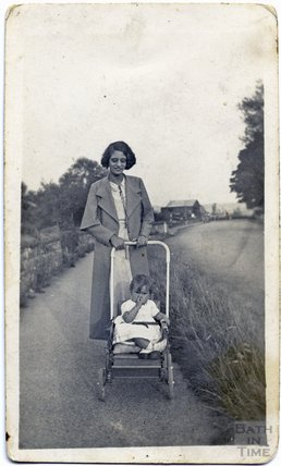 Lady with a pram on the Lower Bristol Road near Twerton, c.1930s