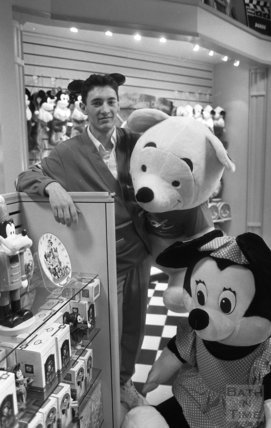 Disney Store cast member Chad Laker with some friends in the newly opened store 19 November 1992