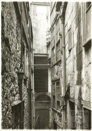 Slippery Lane from the bottom of Northgate Street, adjoining Clack's fishmonger, Bath 1936