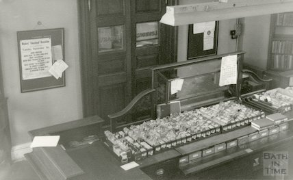 Bath Municipal Library, Bridge Street - lending library interior showing counter, 1954