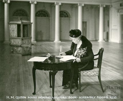 Assembly Rooms - H.M. Queen Mary signing the visitors book, 1938