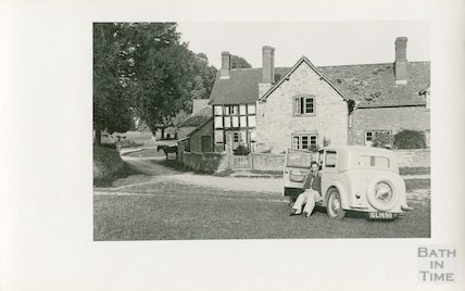 One of the photographer's twin boys and their trust car at Kilpeck, Herefordshire, c.1930s