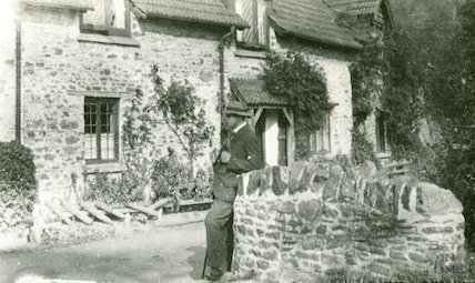 Unidentified cottage with George Love Dafnis in the foreground, c.1930s