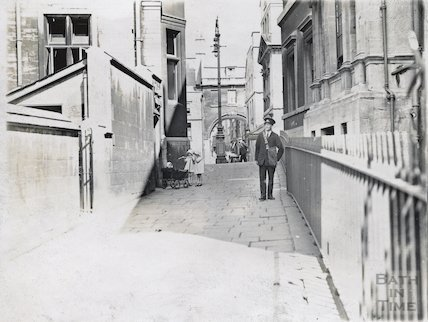 Postman and twin girls with pram, Bridewell Lane, Bath, c.1920s