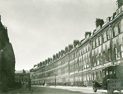 Henrietta Street with postman standing in the shadows, c.1940s