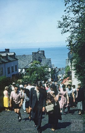 Walking up the cobbles in Clovelly, North Devon, c.1959