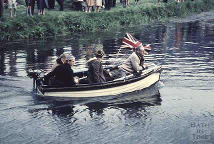 Men in a small boat powered by a Seagull outboard on the Kennet and Avon Canal near Dundas c.1960
