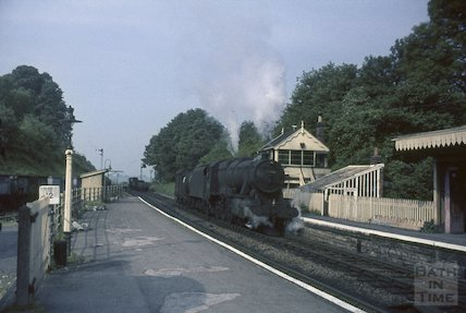 A steam train approaches Midsomer Norton railway station, c.1965