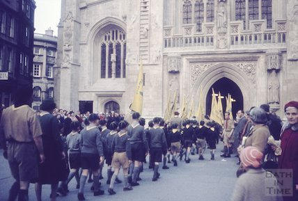 Cub scouts marching into the West Door of Bath Abbey, c.1960s