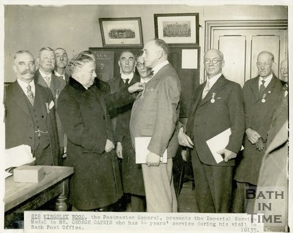 Sir Kingsley Wood, Postmaster General, presenting George Love Dafnis with the Imperial Service Medal, 15th January 1935