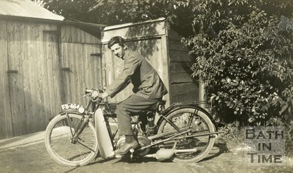 A young man posing on a 1925 New Imperial motorcycle