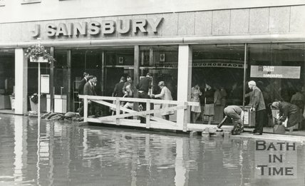 Customers being helped into J. Sainsbury's, Southgate Street, Bath during the floods 1968