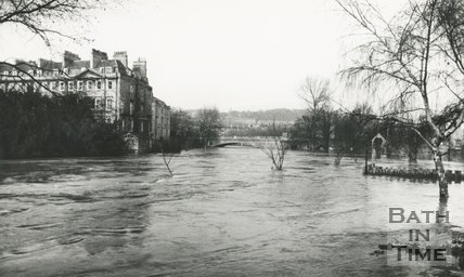 View along the flooded River Avon towards North Parade Bridge, Bath 1960