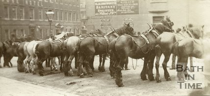 A row of horses waiting to drink from the fountain at the bottom of Lansdown Road, Bath c.1890