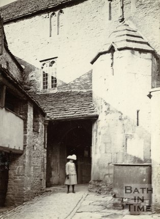 A girl posing in the courtyard of the George Inn, Norton St. Philip, near Bath, c.1901