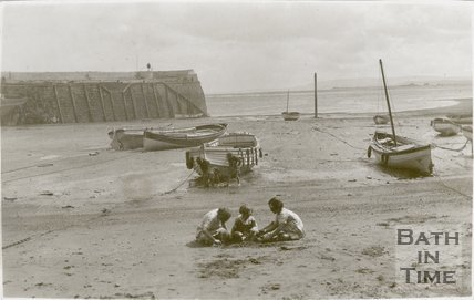 Children playing on the beach at Minehead Harbour, Somerset, c.1920s