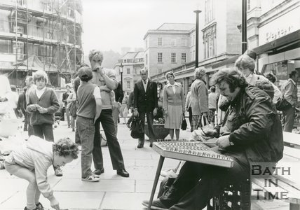 Jim Couza playing his hammered dulcimer in Union Street, Bath, 1984