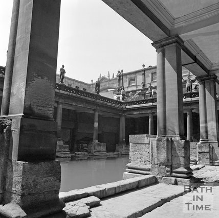 View from the Roman Baths towards the arch over York Street, Bath, c.1977