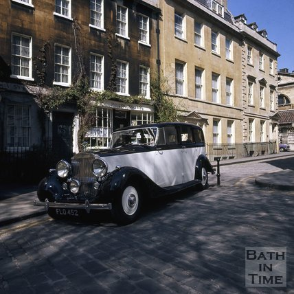 A Rolls Royce limousine outside Philippa Savery Antiques in Abbey Green, Bath, c.1975