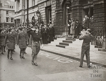 The Princess Elizabeth takes a salute from the Womens Land Army outside the Guildhall, Bath 1945