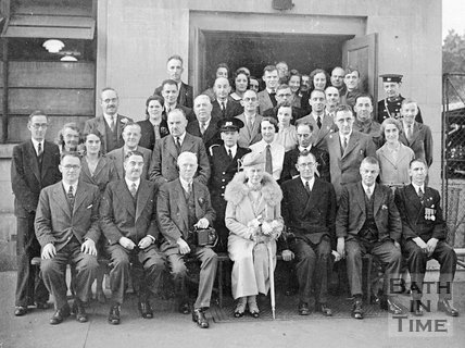 Queen Mary posing in a group photo at an unidentified location in Bath? , c.1940