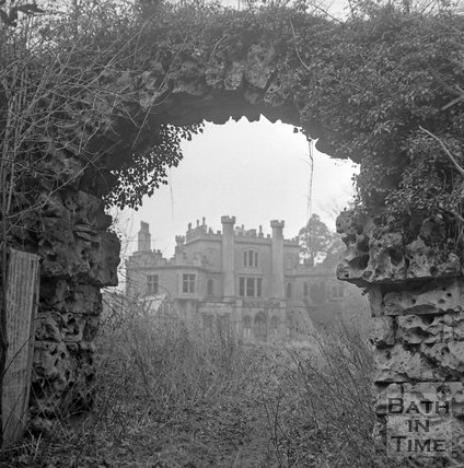 A view of Battlefields House, Lansdown, near Bath through a rustic stone archway, January 1 1972