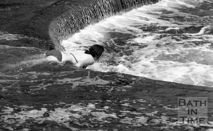 Swimmers at the weir at Pulteney Bridge, Bath, 28 June 1976