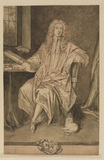 Portrait of a man seated at a desk