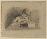 Young boy writing at a table