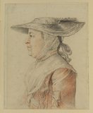 Bust length profile view to left of a woman in a hat