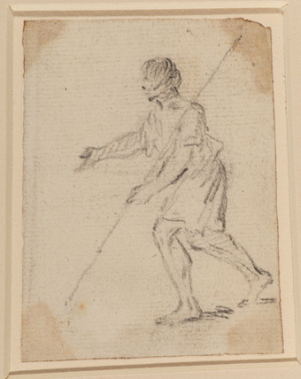 Male figure with a staff