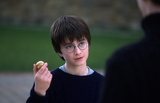 Harry holding Golden Snitch™