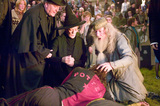 Harry lying over Cedric's dead body with Fudge, McGonagall & Dumbledore