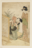 Two girls, one kneeling down and holding a child, the other standing