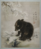 Black bear cub in snow