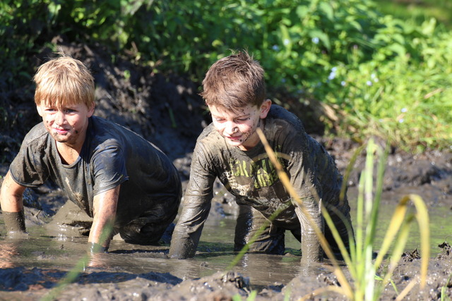 boys and girls have swx in mud