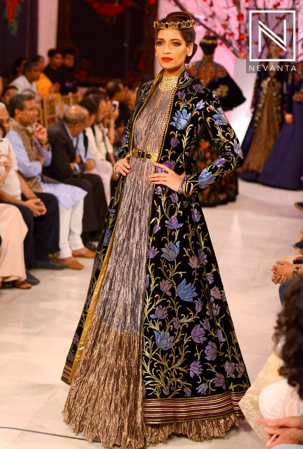 A Floral Embroidered Long Jacket Sported Over An Evening Gown By