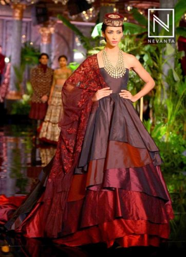 Asymmetric lehengas have drapes clinging to the waist line panel giving an unbalanced look
