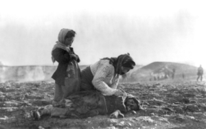 csm_Armenian_woman_kneeling_beside_dead_child_in_field_1cd1fd2478