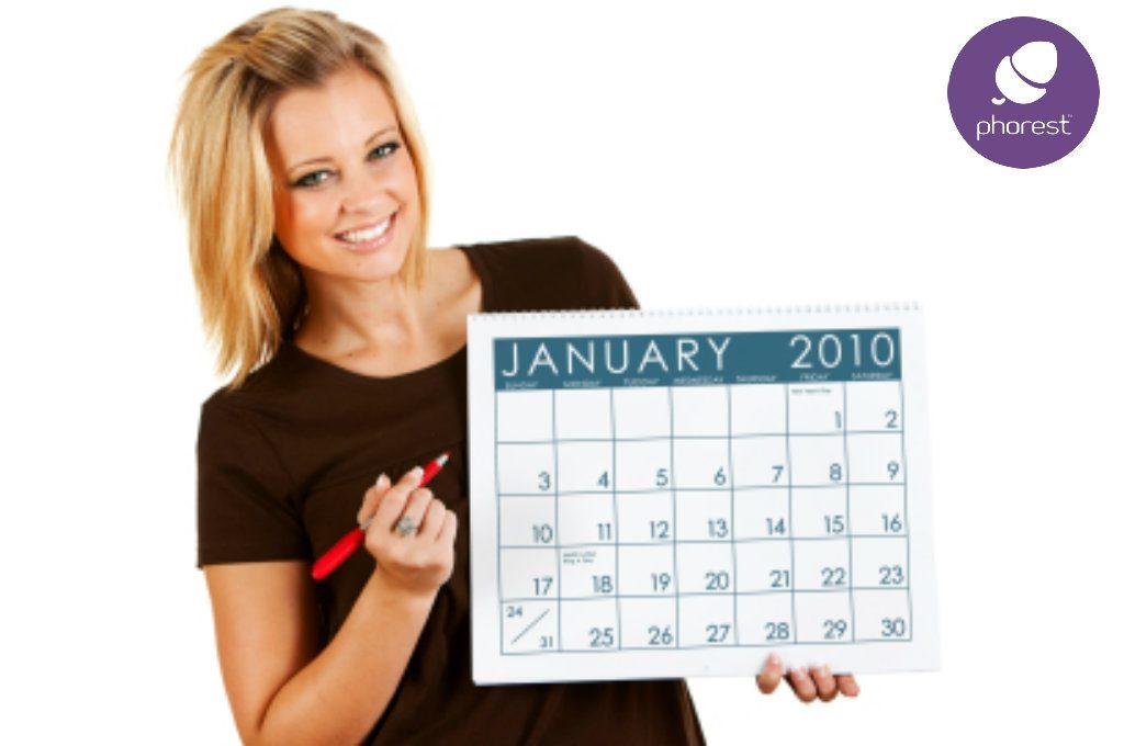 Woman holding January 2010 calendar