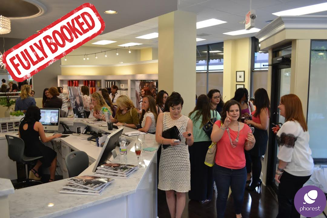 busy salon lots of happy customers