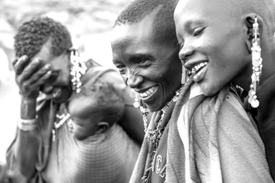 Masai women laughing in black and white