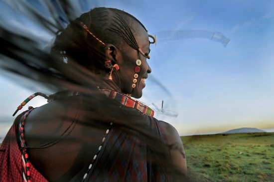 A traditionally dressed Maasai Moran person with braids