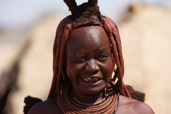 A close up of a Himba lady with braids