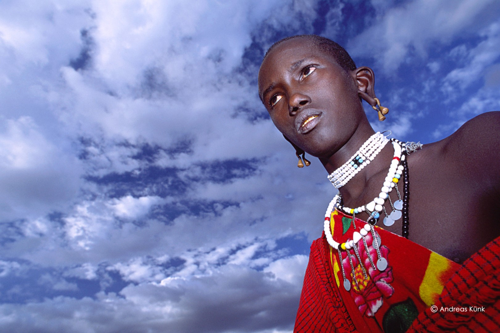 A close up of a traditional dressed Maasai person