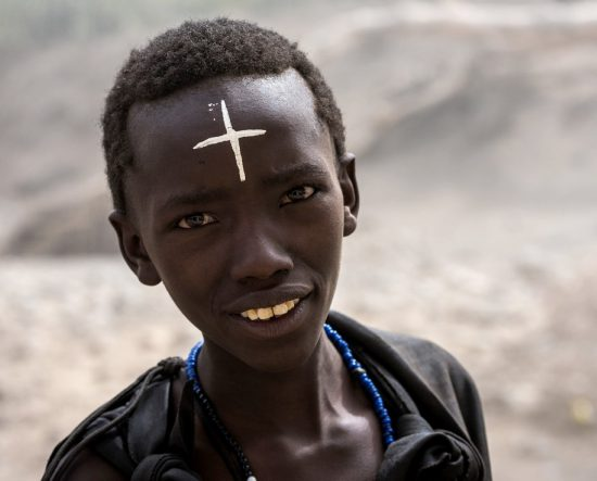 A traditional Maasai boy undergoing his rite of passage in Tanzania.
