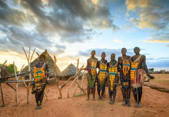 Traditionally dressed men in Omo Valley in Ethiopia, one of the most ethnic and culturally diverse parts of the world.